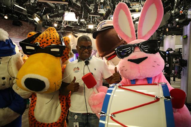 <p>Fudgie the Whale photobombs a staff member posing with Chester the Cheetah and Energizer Bunny at Yahoo Studios in New York City on Sept. 25, 2017. (Photo: Gordon Donovan/Yahoo News) </p>