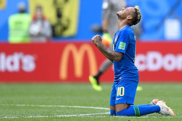 Neymar celebrates after scoring to help Brazil beat Costa Rica 2-0 (AFP Photo/GABRIEL BOUYS )