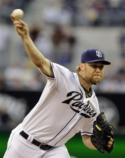 San Diego Padres starting pitcher Andrew Cashner releases a pitch against the Atlanta Braves in the first inning of a baseball game in San Diego, Tuesday, June 11, 2013. (AP Photo/Lenny Ignelzi)