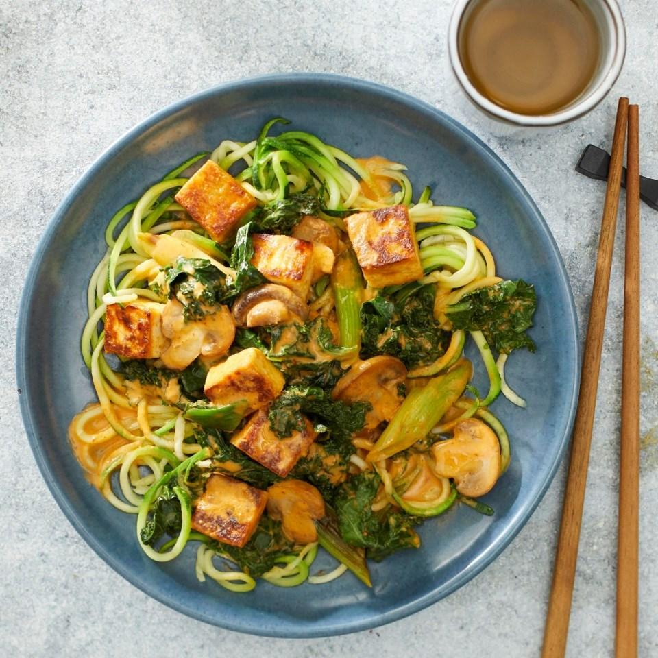 <p>For this quick Thai-inspired curry recipe, we've combined tofu and plenty of veggies with a flavorful sauce made with red curry paste, lime juice and coconut milk. Serve the curry over lightly warmed zucchini noodles to get even more veggies in your weeknight dinner. Bonus: Everything is cooked in one skillet, so there's only one pan to wash after dinner.</p>