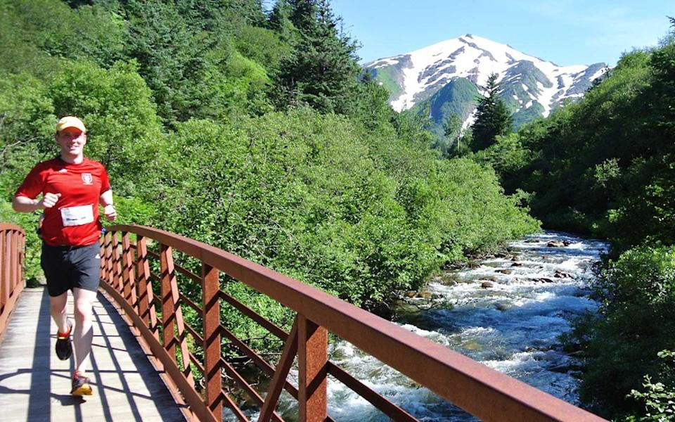 """<p>This <a rel=""""nofollow noopener"""" href=""""http://www.travelandleisure.com/photography/alaska-adventure-photography"""" target=""""_blank"""" data-ylk=""""slk:Alaskan"""" class=""""link rapid-noclick-resp"""">Alaskan</a> running cruise allows you to explore multiple locations on foot. A cruise ship takes guests from city to city along the <a rel=""""nofollow noopener"""" href=""""http://www.travelandleisure.com/airlines-airports/alaska-airlines/wifi-on-alaska-airlines"""" target=""""_blank"""" data-ylk=""""slk:Alaskan"""" class=""""link rapid-noclick-resp"""">Alaskan</a> coast, and then they disembark for running and walking excursions on the trails.</p> <p><a rel=""""nofollow noopener"""" href=""""https://www.runningcruise.com/package/alaska-2018/"""" target=""""_blank"""" data-ylk=""""slk:The cruise"""" class=""""link rapid-noclick-resp"""">The cruise</a> stops in Anchorage, Juneau, Skagway and Ketchikan. It also provides coaching and a 5K race to kick off the excursion. Reservations start at $2,146 per person.</p>"""