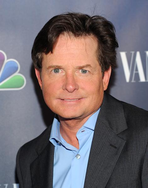 """In this Sept. 16, 2013 file photo, actor Michael J. Fox attends the NBC 2013 Fall season launch party hosted by Vanity Fair at Le Bain, in New York. The Nielsen company said Friday, Sept. 27, 2013, that Robin Williams' new CBS comedy, """"The Crazy Ones,"""" debuted before 15.6 million people on Thursday night. It competed directly at 9 p.m. Eastern with """"The Michael J. Fox"""" on NBC, which was seen by 7.2 million people. (Photo by Evan Agostini/Invision/AP)"""