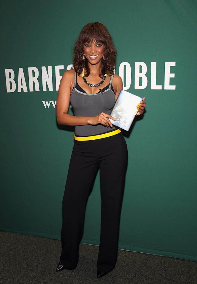 "No, Tyra Banks' book, <i>Modelland</i> isn't her biography, it's a novel the ""America's Next Top Model"" host wrote about four girls who get into modelling school. The 37-year-old happily posed with a copy during an event at Barnes & Noble in New York's Union Square. Paul Zimmerman/<a href=""http://www.gettyimages.com/"" target=""new"">GettyImages.com</a> - September 21, 2011"