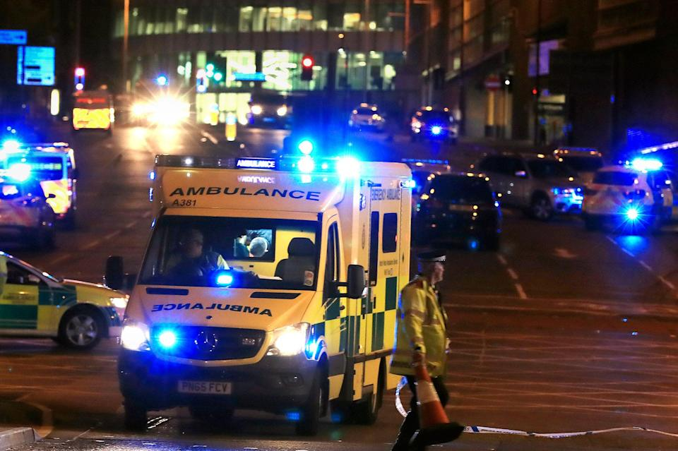 <p>Emergency services work at Manchester Arena after reports of an explosion at the venue during an Ariana Grande gig in Manchester, England, Monday, May 22, 2017. Several people have died following reports of an explosion Monday night at an Ariana Grande concert in northern England, police said. A representative said the singer was not injured. (Peter Byrne/PA via AP) </p>