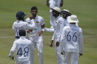 Sri Lanka Players celebrate the wicket of South Africa's Temba Bavuma, on day three of the first cricket test match between South Africa and Sri Lanka at Super Sport Park Stadium in Pretoria, South Africa, Monday, Dec. 28, 2020. (AP Photo/Catherine Kotze)