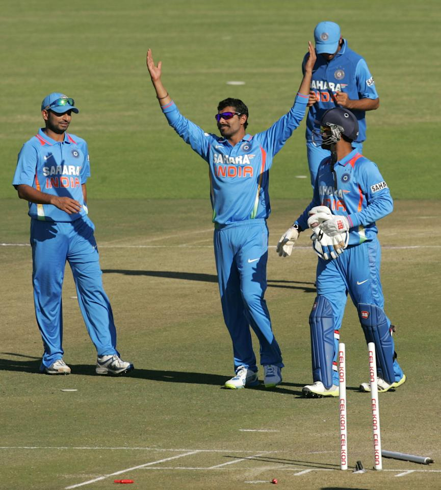 Indian bowler Ravindra Jadeja (C) celebrates a wicket with his team mates during the second one-day international ODI series between hosts Zimbabwe and India at Harare Sports Club on July 26, 2013. AFP PHOTO / Jekesai Njikizana.        (Photo credit should read JEKESAI NJIKIZANA/AFP/Getty Images)