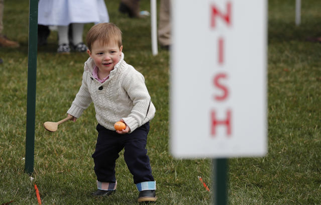 <p>A young child participates in the annual White House Easter Egg Roll on the South Lawn of the White House in Washington, U.S., April 2, 2018. (Photo: Carlos Barria/Reuters) </p>
