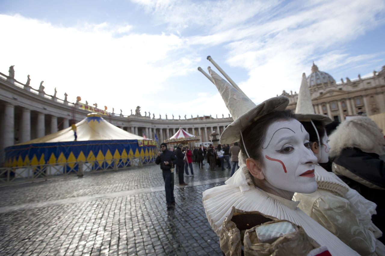 A circus tent and worker in St. Peter's Square at the Vatican, Saturday, Dec. 1, 2012, at the end of an audience Pope Benedict XVI earlier granted to circus artists and workers. Benedict clapped and watched amused as circus workers flipped, flopped, juggled and twisted before him in what the Vatican has called a historic audience to make street performers and other itinerant entertainers feel like they belong to the church. (AP Photo/Andrew Medichini)