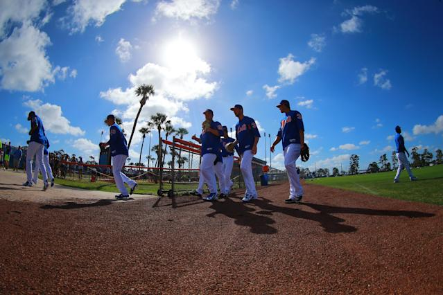 <p>New York Mets pitchers leave the field after morning stretches at First Data Field in Port St. Lucie, Fla., Feb. 24, 2018. (Photo: Gordon Donovan/Yahoo News) </p>