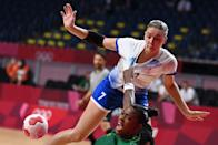 <p>Brazil's pivot Tamires De Araujo (down) is challenged by Russia's centre back Daria Dmitrieva during the women's preliminary round group B handball match between Russia and Brazil of the Tokyo 2020 Olympic Games at the Yoyogi National Stadium in Tokyo on July 25, 2021. (Photo by Daniel LEAL-OLIVAS / AFP)</p>