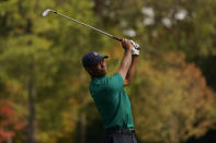 Tiger Woods watches his tee shot on the 12th hole during a practice round for the Masters golf tournament Monday, Nov. 9, 2020, in Augusta, Ga. (AP Photo/Charlie Riedel)