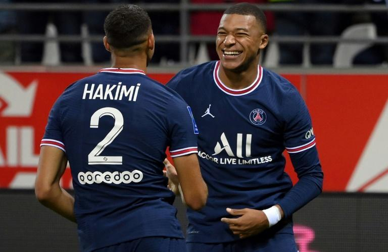 Kylian Mbappe celebrates with Achraf Hakimi after scoring PSG's second goal against Reims (AFP/FRANCK FIFE)