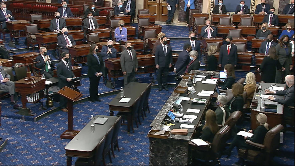 In this image from video, House impeachment managers arrive in the Senate chamber as they transmit the article of impeachment alleging incitement of insurrection against former President Donald Trump, in Washington, Monday, Jan. 25, 2021. Lead impeachment manager Rep. Jamie Raskin, D-Md., read the article of impeachment to the senators. (Senate Television via AP)