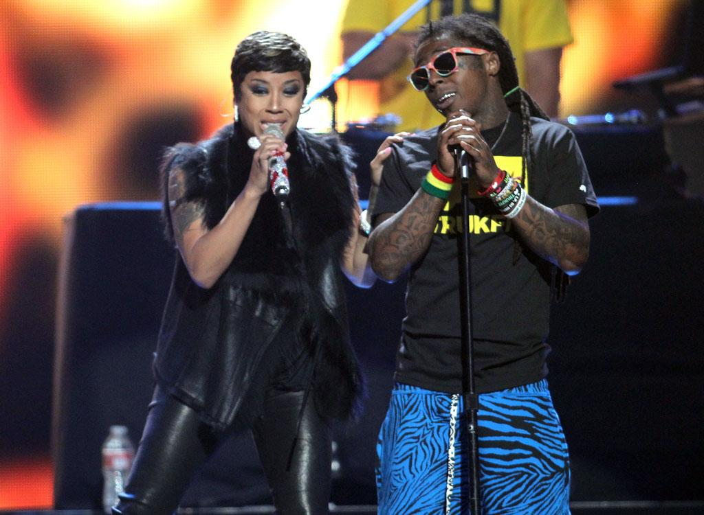 LAS VEGAS, NV - SEPTEMBER 21:  Singer Keyshia Cole (L) and rapper Lil' Wayne perform onstage during the 2012 iHeartRadio Music Festival at the MGM Grand Garden Arena on September 21, 2012 in Las Vegas, Nevada.  (Photo by Isaac Brekken/Getty Images for Clear Channel)