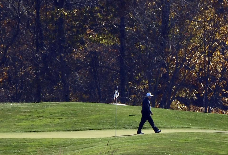 US President Donald Trump walks the golf course at Trump National Golf Club on November 7, 2020 in Sterling, Virginia. - Democrat Joe Biden has won the White House, US media said November 7, defeating Donald Trump and ending a presidency that convulsed American politics, shocked the world and left the United States more divided than at any time in decades. (Photo by Olivier DOULIERY / AFP) (Photo by OLIVIER DOULIERY/AFP via Getty Images)