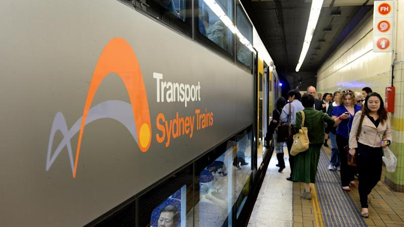 A broken down train and power outage at a Sydney train station are causing commuter chaos.
