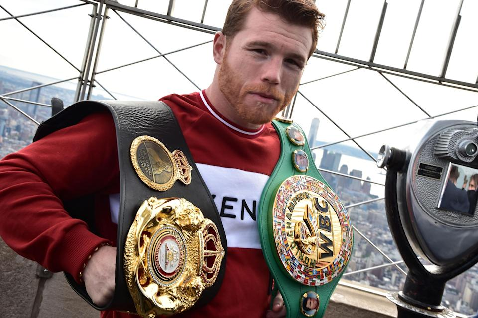 Canelo Alvarez shows off his title belts on Oct. 16, 2018, at the Empire State Building in New York City ahead of his championship match vs. Rocky Fielding at Madison Square Garden on Dec. 15. (Getty Images)