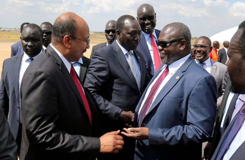 South Sudan's ex-vice President and former rebel leader Machar is received as he arrives at the Juba International Airport, in Juba