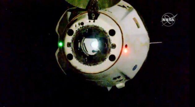 A camera on the exterior of the International Space Station shows SpaceX's Crew Dragon capsule backing away to begin the homeward journey for NASA astronauts Doug Hurley and Bob Behnken. (NASA via YouTube)