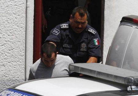 Tahmooressi is escorted out of a court house in Tijuana