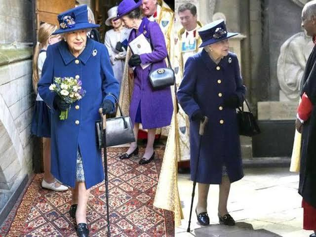 Queen Elizabeth II uses a cane to walk into Westminster Abbey