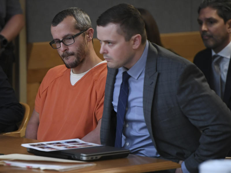 GREELEY CO - NOVEMBER 19: Christopher Watts looks at a set of family photo sitting on top his attorneys laptop in court during his sentencing hearing, at the Weld County Courthouse, on November 19, 2018 in Greeley, Colorado. Watts was sentenced to life in prison for murdering his pregnant wife, daughters. (Photo by RJ Sangosti/The Denver Post via Getty Images)