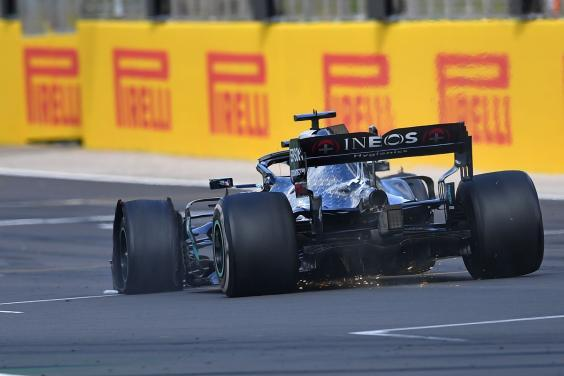 Hamilton crossed the line to win the British Grand Prix with a puncture (AFP via Getty)