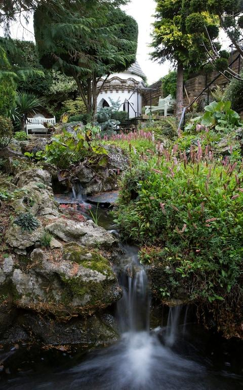 A waterfall in the garden - Credit: HEATHCLIFF O'MALLEY FOR THE TELEGRAPH
