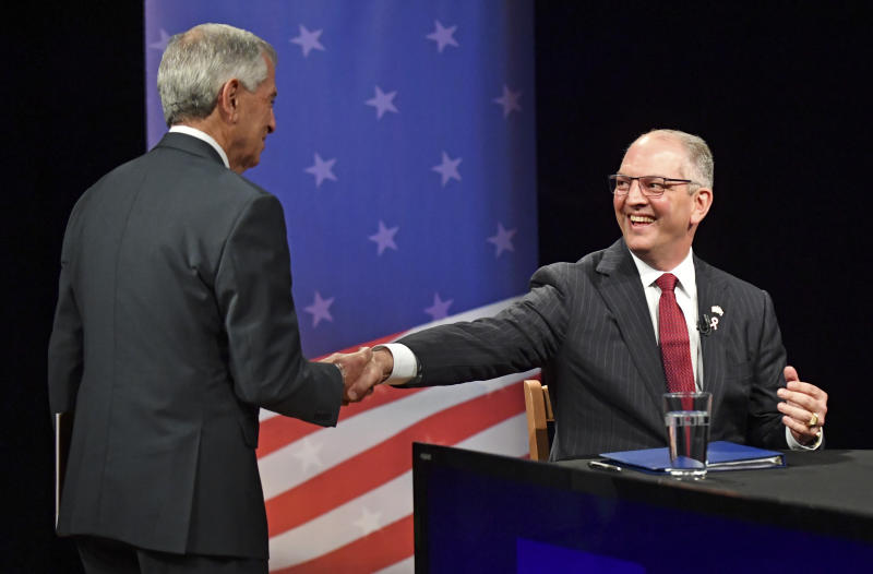 Republican candidate Eddie Rispone, left, and Democratic Louisiana Gov. John Bel Edwards shake hands on set before the start of the Louisiana Governor's runoff debate, Wednesday, Oct. 30, 2019, at Louisiana Public Broadcasting in Baton Rouge, La. (Hilary Scheinuk/The Advocate via AP)