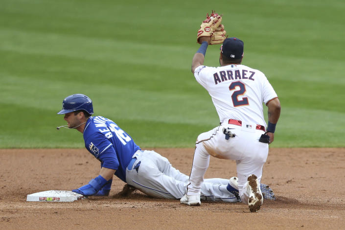Minnesota Twins second baseman Luis Arraez, right, tags Kansas City Royals' Andrew Benintendi, left, out at second base after trying to steal the base in the first inning of a baseball game Sunday, May 2, 2021, in Minneapolis. (AP Photo/Stacy Bengs)