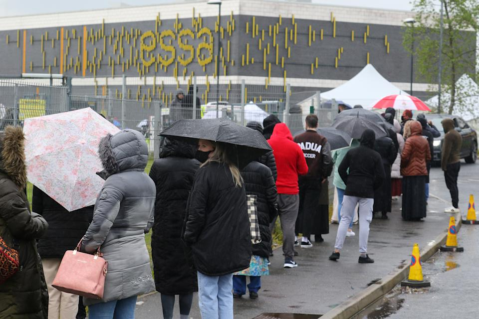 Thousands of people are queued Bolton on saturday. (SWNS)