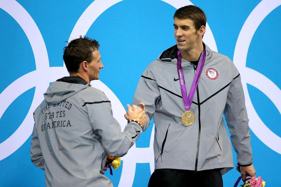 <p>Gold medallist Michael Phelps shakes hands with silver medallist Ryan Lochte during the medal ceremony for the 200-meter individual medley final at the London 2012 Olympic Games on August 2, 2012. (Ezra Shaw/Getty Images)</p>