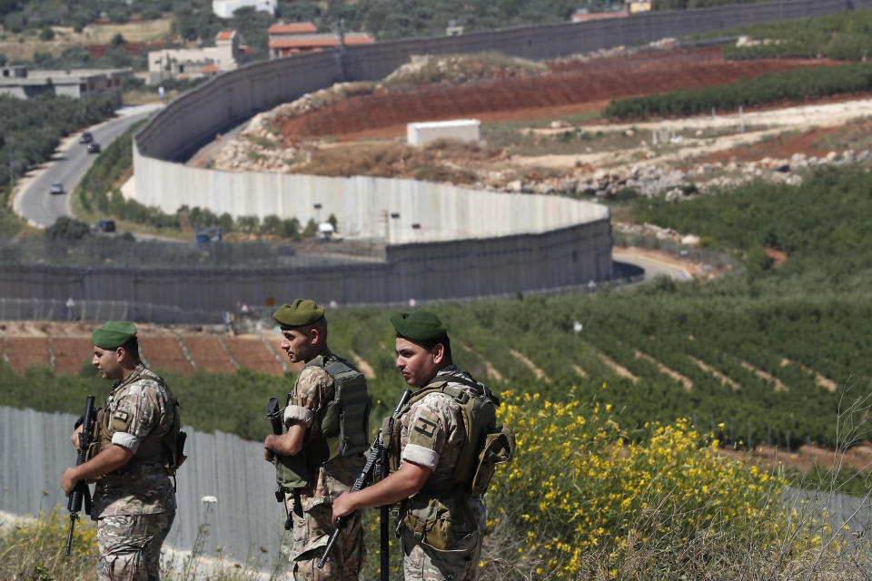 FILE - In this May 15, 2021 file photo, Lebanese army soldiers deploy at the Lebanese side of the Lebanese-Israeli border in the southern village of Kfar Kila, Lebanon. The currency collapse has wiped out the salaries of the U.S.-backed Lebanese military, placed unprecedented pressure on the army's operational capabilities with some of the highest attrition rates over the past two years, and raised concerns about its ability to continue playing a stabilizing role while sectarian tensions and crime are on the rise. (AP Photo/Hussein Malla, File)