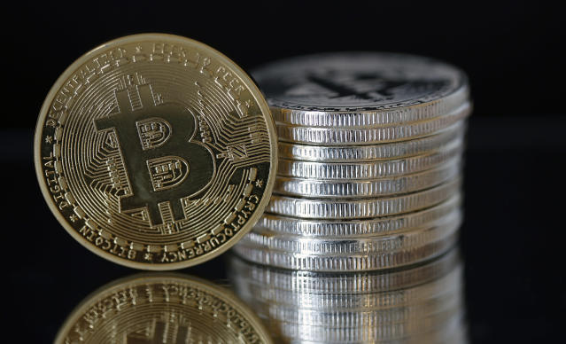 Bitcoin silver and gold commemorative coins. Actual bitcoins are intangible digital assets. (Reuters)