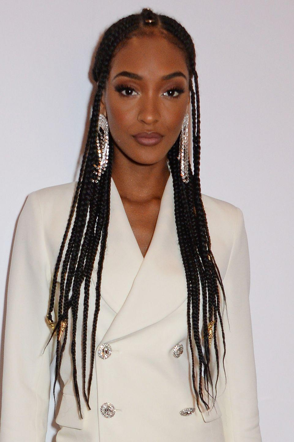 <p>Add a little something extra to your half-up look with some beading like Jourdan Dunn. Her stunning braids are styled in a half- up, half-down look and finished with gold and silver accents.</p>