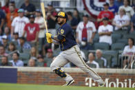 Milwaukee Brewers' Omar Narvaez (10) follows through on his RBI single against the Atlanta Braves during the fourth inning of Game 4 of a baseball National League Division Series, Tuesday, Oct. 12, 2021, in Atlanta. (AP Photo/Brynn Anderson)