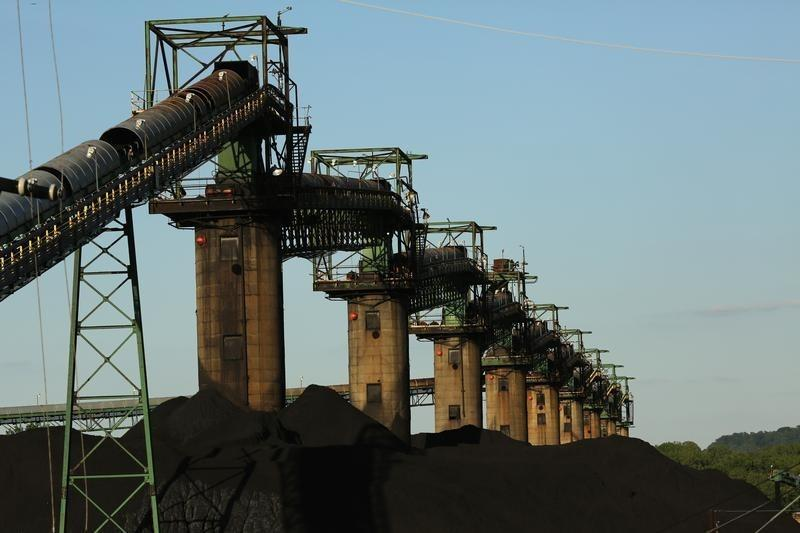 Coal is stacked at the base of coal loaders along the Ohio River in Ceredo