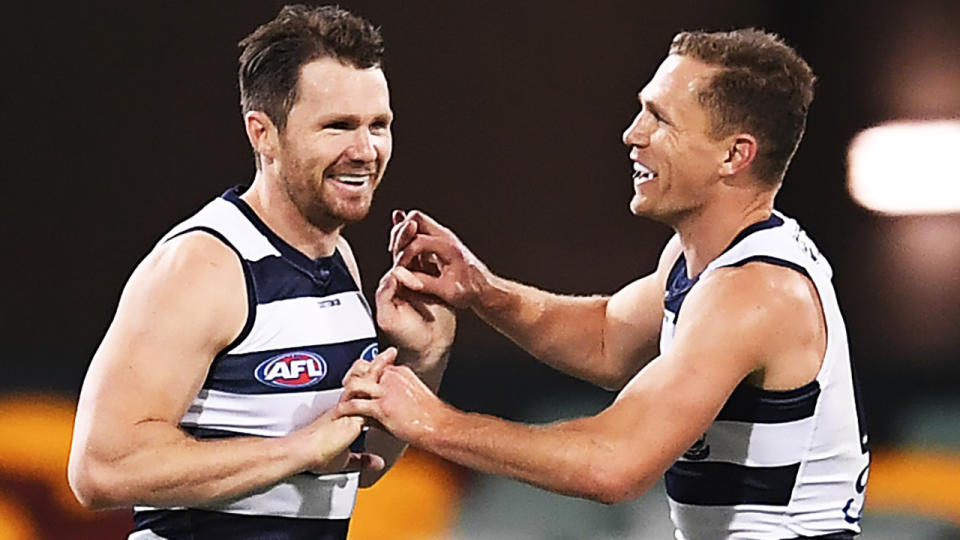 Patrick Dangerfield and Joel Selwood are pictured celebrating a goal.