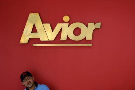 A man sits in front of the corporate logo of Avior Airlines at their office in Caracas, Venezuela May 15, 2019. REUTERS/Manaure Quintero NO RESALES. NO ARCHIVES.