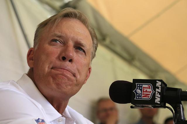 John Elway, Denver Broncos executive vice president of football operations, pauses while talking to the media during a news conference announcing that Broncos owner Pat Bowlen is giving up control of the team because of Alzheimer's disease, Wednesday, July 23, 2014, at the teams headquarters in Englewood, Colo. (AP Photo/Jack Dempsey)