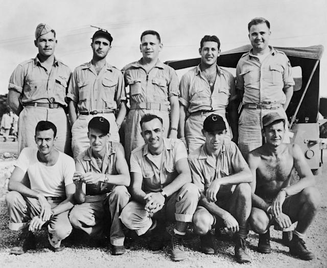 <p>The crew of the United States Army Air Forces B-29 Superfortress 'Bockscar', which dropped the atomic bomb 'Fat Man' on the Japanese city of Nagasaki on Aug. 9, 1945. Front row, left to right: flight engineer John D. Kuharek, gunner and assistant flight engineer Ray Gallagher, tail gunner Albert Dehart, radio operator Abe Spitzer, unknown. Back row, left to right: bombardier Raymond 'Kermit' Beahan, navigator James Van Pelt, co-pilot Charles Donald Albury, co-pilot Fred Olivi and pilot Major General Charles W. Sweeney. (Photo: FPG/Hulton Archive/Getty Images) </p>