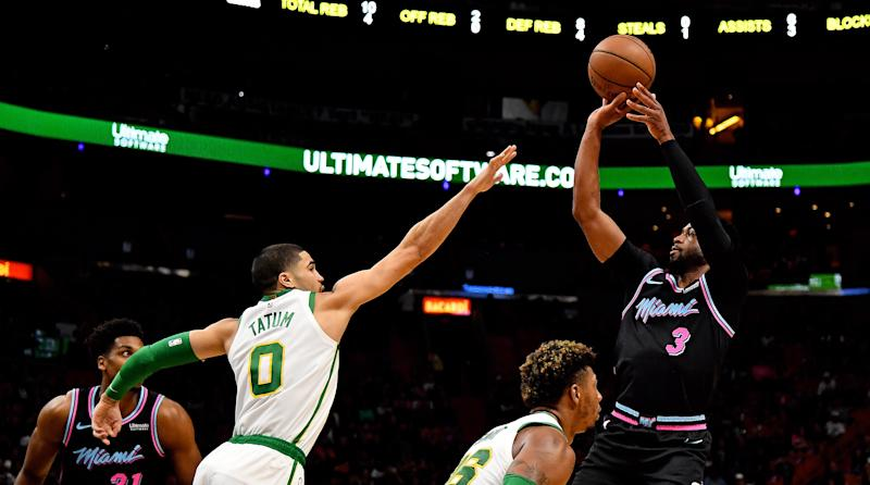 Wade powers Heat to blowout win over Celtics