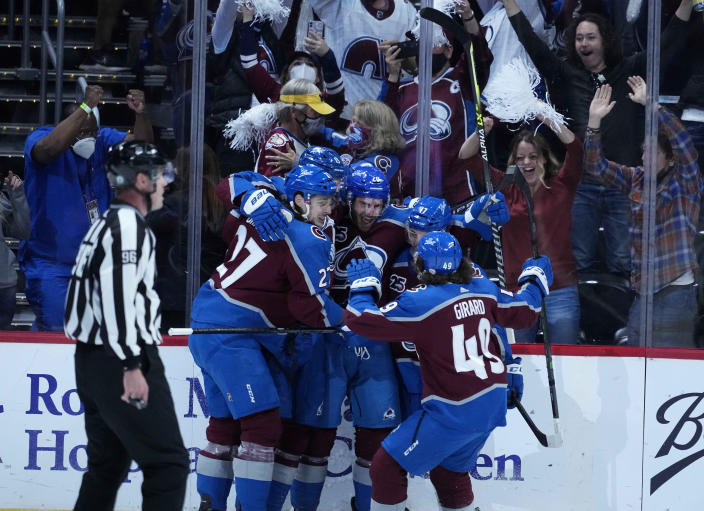Colorado Avalanche left wing Brandon Saad (20) is congratulated by teammates after his goal against the Vegas Golden Knights during the first period in Game 2 of an NHL hockey Stanley Cup second-round playoff series Wednesday, June 2, 2021, in Denver. (AP Photo/Jack Dempsey)