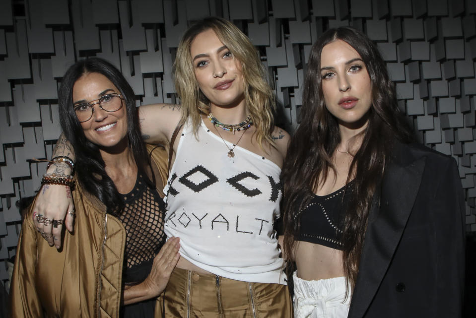 Demi Moore, from left, Paris Jackson and Scout Willis arrive for the Stella McCartney Spring-Summer 2022 ready-to-wear fashion show presented in Paris, Monday, Oct. 4, 2021. (Photo by Vianney Le Caer/Invision/AP)