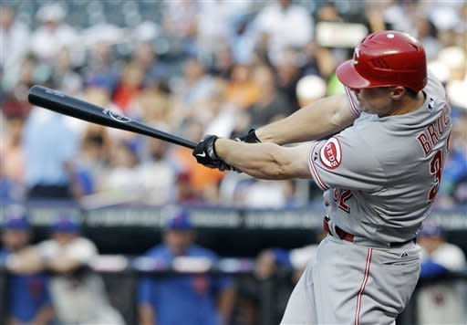 Cincinnati Reds' Jay Bruce follows through on a three-run home run during the first inning of a baseball game against the New York Mets, Saturday, June 16, 2012, in New York. (AP Photo/Frank Franklin II)