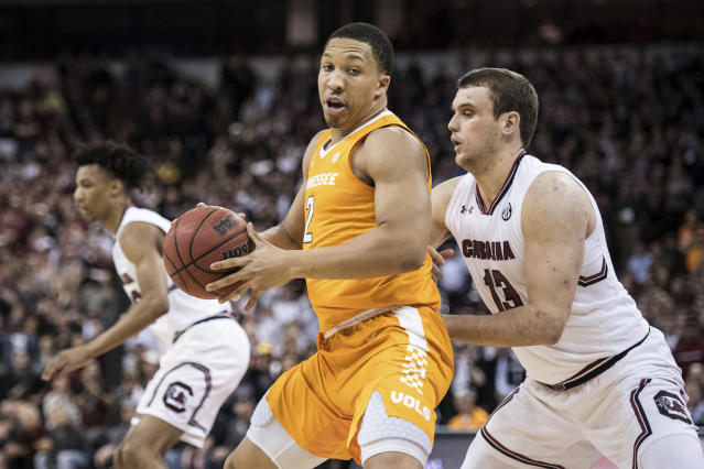 Tennessee forward Grant Williams (2) drives to the hoop against South Carolina forward Felipe Haase (13) during the first half of an NCAA college basketball game Tuesday, Jan. 29, 2019, in Columbia, S.C. (AP Photo/Sean Rayford)