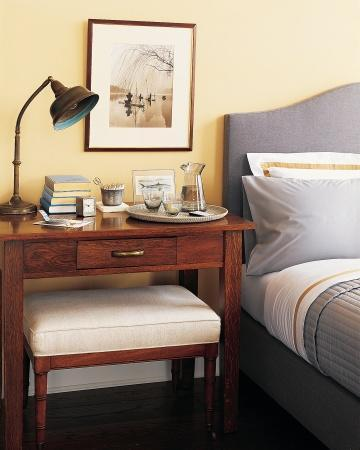 """<div class=""""caption-credit""""> Photo by: Martha Stewart Living</div><b>Bedside Work Surface</b> <br> If space allows, a desk is an excellent choice beside the bed. Its large surface area is convenient for files or correspondence and leaves room for luxuries, such as a drink tray. The gooseneck lamp can be pointed toward the work surface or the bed. The bench slides underneath, out of the way, when not in use. <br> <b>Related:</b> <br> <b><a href=""""http://www.marthastewart.com/275539/bedroom-decorating-ideas/@center/277006/bedroom-and-bathroom-decorating?xsc=synd_yshine"""" rel=""""nofollow noopener"""" target=""""_blank"""" data-ylk=""""slk:23 Ways to Decorate Your Bedroom"""" class=""""link rapid-noclick-resp"""">23 Ways to Decorate Your Bedroom</a> <br> <a href=""""http://www.marthastewart.com/275280/bathroom-organization-tips/@center/277006/bedroom-and-bathroom-decorating?xsc=synd_yshine"""" rel=""""nofollow noopener"""" target=""""_blank"""" data-ylk=""""slk:24 Ways to Organize Your Bathroom"""" class=""""link rapid-noclick-resp"""">24 Ways to Organize Your Bathroom</a></b> <br>"""