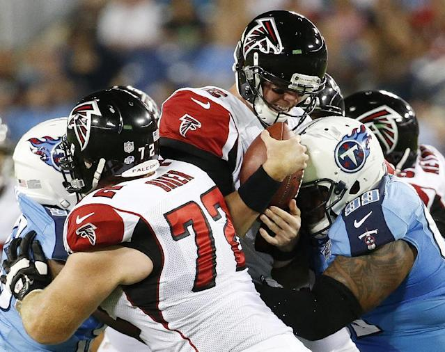 Atlanta Falcons quarterback Matt Ryan (2) is hit by Tennessee Titans defensive tackle Jurrell Casey (99) as Atlanta Falcons tackle Sam Baker (72) blocks during the first half of an NFL preseason football game, Saturday, Aug. 24, 2013, in Nashville, Tenn. (AP Photo/John Russell)