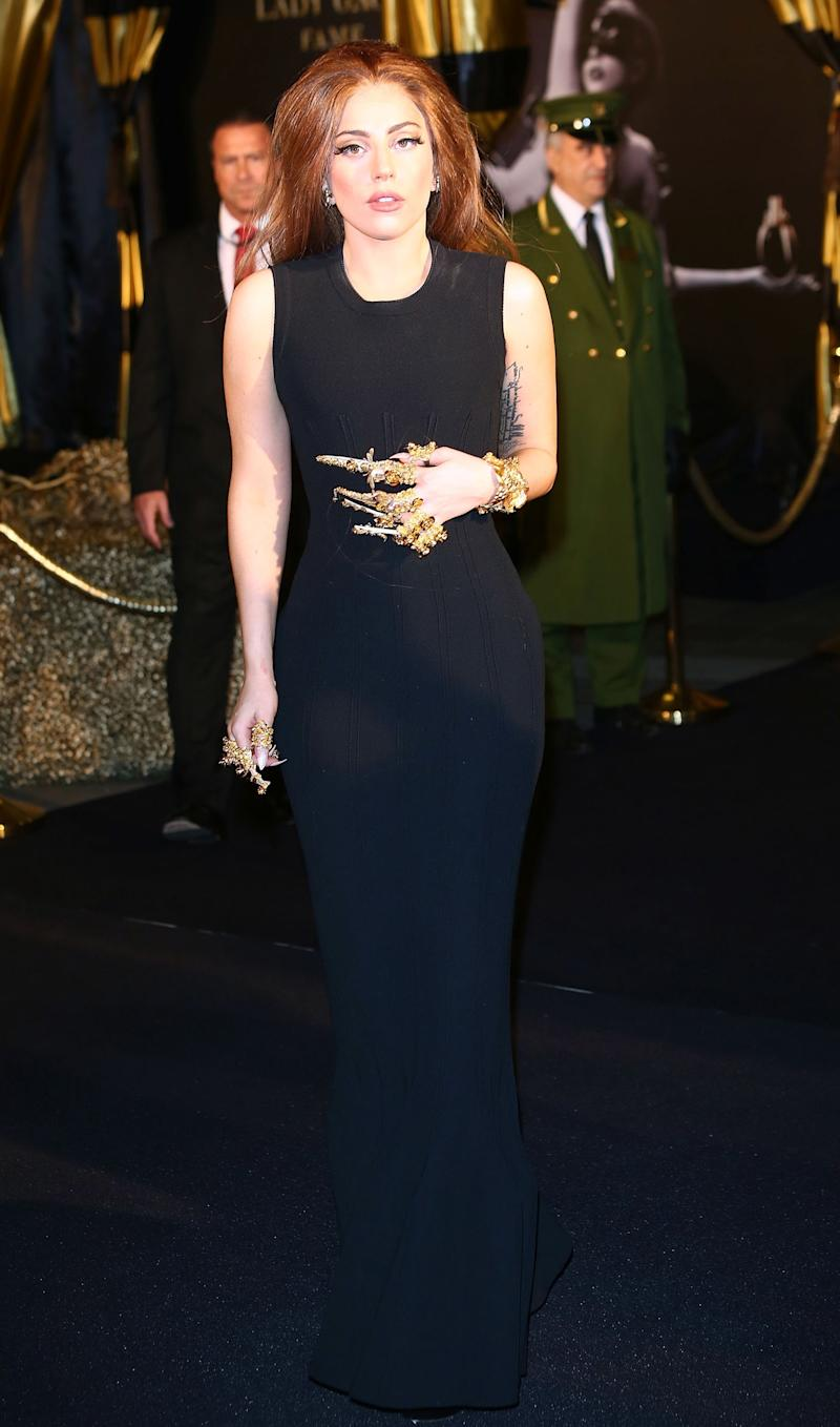 A radiant brunette Lady Gaga at Harrods for the launch of her fragrance, Fame.