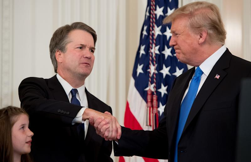 Judge Brett Kavanaugh shakes hands with President Donald Trump after the announcement of his nomination to the Supreme Court in the East Room of the White House on Monday. (SAUL LOEB/AFP/Getty Images)